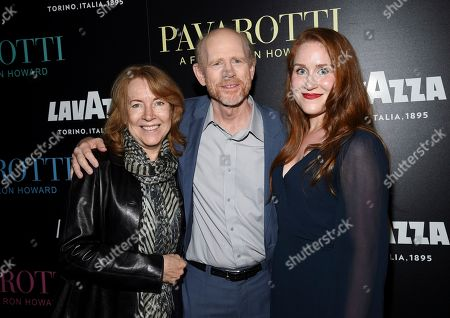 "Cheryl Howard, Ron Howard, Paige Howard. Director Ron Howard, center, poses with wife Cheryl Howard, left, and daughter Paige Howard at a special screening of ""Pavarotti"" at the iPic Theater, in New York"