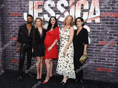 """Krysten Ritter, Carrie-Anne Moss, Melissa Rosenberg, Eka Darville, Rachael Taylor. Krysten Ritter, center, star of the Netflix series """"Marvel's Jessica Jones,"""" poses with from left, cast members Eka Darville and Rachael Taylor, creator/executiver producer Melissa Rosenberg and cast member Carrie-Anne Moss at a special screening of the show at the ArcLight Hollywood, in Los Angeles"""