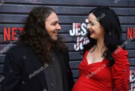 """Krysten Ritter, Adam Granduciel. Krysten Ritter, right, star of the Netflix series """"Marvel's Jessica Jones,"""" shares a laugh with her boyfriend, musician Adam Granduciel, at a special screening of the show at the ArcLight Hollywood, in Los Angeles"""