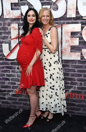 """Krysten Ritter, Melissa Rosenberg. Krysten Ritter, left, star of the Netflix series """"Marvel's Jessica Jones,"""" poses with creator/executive producer Melissa Rosenberg at a special screening of the show at the ArcLight Hollywood, in Los Angeles"""