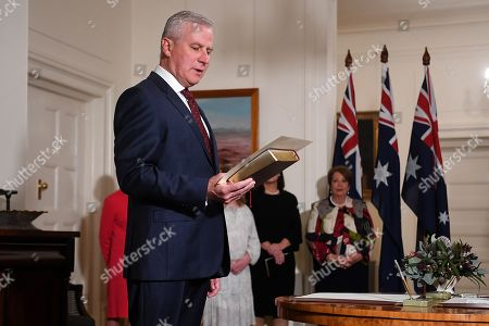 Australian Deputy Prime Minister Michael McCormack (L) and Governor-General Sir Peter Cosgrove (not pictured) take part in swearing in ceremony at Government House in Canberra, Australia, 29 May 2019. The 46th Australian parliament is expected to open in the first week of July, 2019.