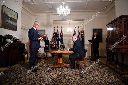 Australian Deputy Prime Minister Michael McCormack (L) and Governor-General Sir Peter Cosgrove (C) take part in swearing in ceremony at Government House in Canberra, Australia, 29 May 2019. The 46th Australian parliament is expected to open in the first week of July, 2019.