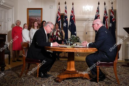 Australian Prime Minister Scott Morrison (L) and Governor-General Sir Peter Cosgrove (R) take part in swearing in ceremony at Government House in Canberra, Australia, 29 May 2019. The 46th Australian parliament is expected to open in the first week of July, 2019.