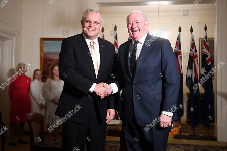 Australian Prime Minister Scott Morrison (L) and Governor-General Sir Peter Cosgrove (R) pose for photos during a swearing in ceremony at Government House in Canberra, Australia, 29 May 2019. The 46th Australian parliament is expected to open in the first week of July, 2019.