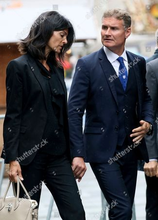 Former F1 driver David Coulthard, right, and his wife Karen Minier, left, arrive for a funeral service for former Formula One driver Niki Lauda in Vienna, Austria, . Three-time Formula One world champion Niki Lauda, who won two of his titles after a horrific crash that left him with serious burns and went on to become a prominent figure in the aviation industry, has died on May 21, 2019. He was 70