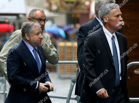 Former F1 team manager Jean Todt, front left, and the CEO of the Formula One Group, Chase Carey, front right, arrive for a funeral service for former Formula One driver Niki Lauda in Vienna, Austria, . Three-time Formula One world champion Niki Lauda, who won two of his titles after a horrific crash that left him with serious burns and went on to become a prominent figure in the aviation industry, has died on May 21, 2019. He was 70