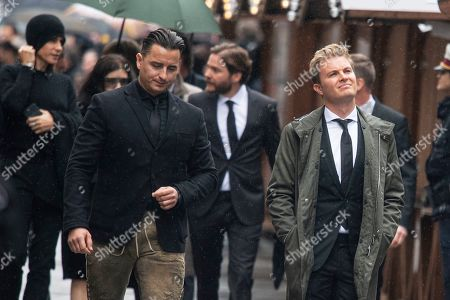 Austrian singer Andreas Gabalier (L) and former German Formula One driver Nico Rosberg (R) arrive for a memorial service for Niki Lauda at Saint Stephen's Cathedral in Vienna, Austria, 29 May 2019. Austrian Formula One legend Niki Lauda died on 20 May 2019 at the age of 70. Lauda won the Formula One championship in 1975, 1977, and 1984 and founded three airlines.