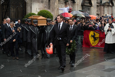 Sons of Niki Lauda, Lukas (L) and Mathias (R) walk in front of morticians carrying the coffin containing the body of Niki Lauda during a memorial service for Niki Lauda at Saint Stephen's Cathedral in Vienna, Austria, 29 May 2019. Austrian Formula One legend Niki Lauda died on 20 May 2019 at the age of 70. Lauda won the Formula One championship in 1975, 1977, and 1984 and founded three airlines.