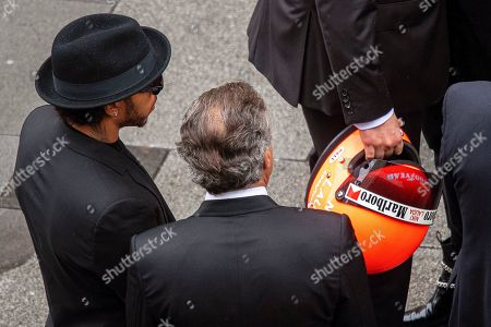 British Formula One driver Lewis Hamilton (L) and former French Formula One driver Jean Alesi (C) stand next to Niki Lauda's son Lukas (R) holding a helmet of his father during a memorial service for Lauda at Saint Stephen's Cathedral in Vienna, Austria, 29 May 2019. Austrian Formula One legend Niki Lauda died on 20 May 2019 at the age of 70. Lauda won the Formula One championship in 1975, 1977, and 1984 and founded three airlines.