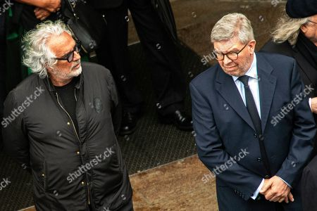 Flavio Briatore (L), Italian businessman and former Formula One team manager of Benetton and Renault, and Formula One managing director of motorsports and technical director, Ross Brawn (R) attend a memorial service for Niki Lauda at Saint Stephen's Cathedral in Vienna, Austria, 29 May 2019. Austrian Formula One legend Niki Lauda died on 20 May 2019 at the age of 70. Lauda won the Formula One championship in 1975, 1977, and 1984 and founded three airlines.