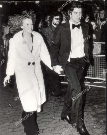 Editorial picture of John Travolta Actor 1978 John Travolta And Kate Edwards Arrive At Leicester Square For The Premiere Of The Film Saturday Night Fever....actor