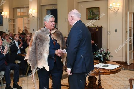 Australian Governor-General Sir Peter Cosgrove shakes hands with Minister for Indigenous Australians Ken Wyatt during the swearing in at Government House in Canberra, Australian Capital Territory, Australia, 29 May 2019. The 46th parliament is expected to open in the first week of July 2019. Ken Wyatt, 66, is the first Aboriginal person ever to hold the post.