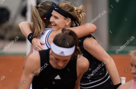 Lucie Safarova of the Czech Republic gets a hug from Sofia Kenin after playing her final career doubles match at the 2019 Roland Garros Grand Slam tennis tournament