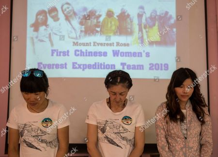 Members of first Chinese women's Everest Expedition 2019 team (L-R) Tsang Ying Hung, Ma Liyamu and Sun Nigning stand during a minute silence for Indian summiteer late Kalpana Dash during a press conference in Kathmandu, Nepal, 29 May 2019. Indian summiteer Kalpana Dash (50) died on 23 May 2019 after scaling the Mount Everest with joint Chinese women expedition team. Nepal is celebrating the 'International Everest Day' with various events on 29 May 2019 commemorating the first climb to the summit on 29 May 1953 by Sir Edmund Hillary and Tenzing Norgay Sherpa.