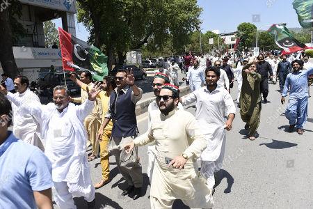 Supporters of opposition party 'Pakistan Peoples' protest and carry the national flag as their party's chairman 'Bilawal Bhutto Zardari' appears in front of the National Accountability Bureau (NAB) in Islamabad, Pakistan, 29 May 2019. Bilawal Bhutto Zardari appeared before NAB on 29 May to record their statements in the fake bank accounts case.