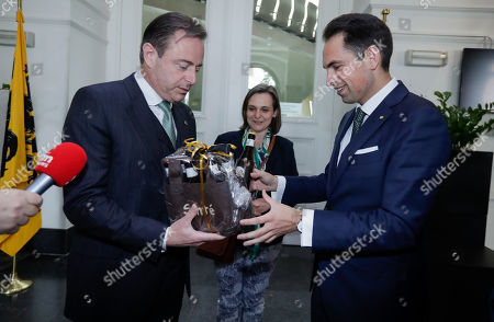 Stock Photo of Bart De Wever, (L) New Flemish Alliance (Nieuw-Vlaamse Alliantie, N-VA) party leader and leader of first party of Flemish part of Belgium and chairman of Vlaams Belang party Tom Van Grieken (R) exchange beers as a gift after a meeting at the Flemish Parliament in Brussels, Belgium, 29 May 2019. The Vlaams Belang party came in second in Flanders region, while the mainstream N-VA party won. Elsewhere, the French-speaking Wallonia region and Brussels saw Socialists and Green party as winners.