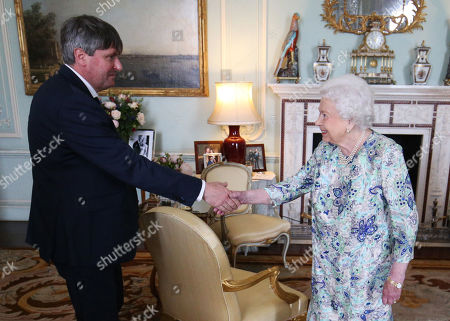 Stock Picture of Queen Elizabeth II receives Simon Armitage to present him with The Queen's Gold Medal for Poetry upon his appointment as Poet Laureate