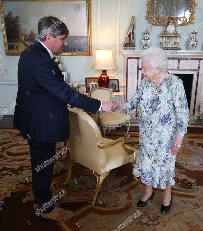 Stock Photo of Queen Elizabeth II receives Simon Armitage to present him with The Queen's Gold Medal for Poetry upon his appointment as Poet Laureate