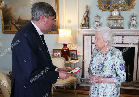Queen Elizabeth II presents Simon Armitage with The Queen's Gold Medal for Poetry upon his appointment as Poet Laureate