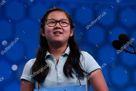 Chloe Park, 12, of Marietta, Ga., reacts after correctly spelling her word as she competes in the third round of the Scripps National Spelling Bee in Oxon Hill, Md