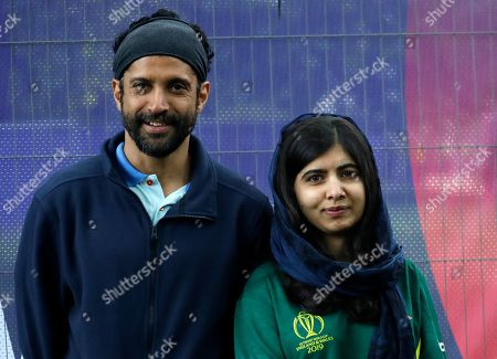Malala Yousafzai, Pakistani Nobel Peace Prize winner, poses for a photograph with Farhan Akhtar, Indian Film Director, during a media opportunity to speak to cricket legends and celebrities from each of the competing nation ahead of the Cricket World Cup opening party along The Mall in London, . The opening Cricket World Cup match takes place on Thursday at The Oval in London
