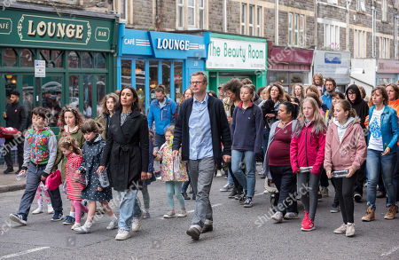 Hugh Fearnley-Whittingstall and Anita Rani take part in filming on North Street in Southville, Bristol, with members of the public campaigning against the use of plastic packaging for the BBC TV series Hugh and Anita's War on Plastic, presented by Hugh Fearnley-Whittingstall and Anita Rani and due for broadcast in June 2019.
