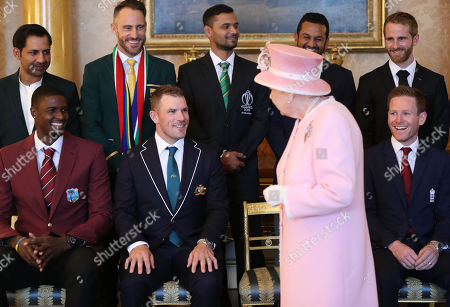 Stock Photo of Queen Elizabeth II joins the captains of the teams taking part in the ICC Cricket World Cup for a photograph in the 1844 Room at Buckingham Palace in London, ahead of the competition's Opening Party on the Mall. Back row, from left: Sarfaraz Ahmed (Pakistan), Francois du Plessis (South Africa), Masrafe Bin Mortaza (Bangladesh), Dimuth Karunaratne (Sri Lanka), Kane Williamson (New Zealand). Front, from left: Jason Holder (West Indies), Aaron Finch (Australia), Queen Elizabeth II, Eoin Morgan (England).