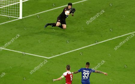 Emerson (R) of Chelsea, Laurent Koscielny (L) of Arsenal and Petr Cech (top) of Arsenal in action during the UEFA Europa League final between Chelsea FC and Arsenal FC at the Olympic Stadium in Baku, Azerbaijan, 29 May 2019.