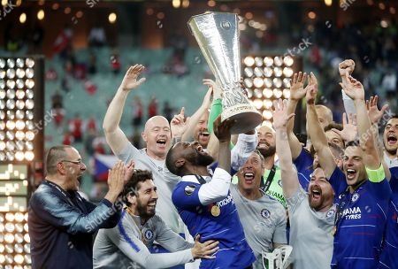 Injured Chelsea player Antonio Ruediger (C) lifts the trophy after the UEFA Europa League final between Chelsea FC and Arsenal FC at the Olympic Stadium in Baku, Azerbaijan, 29 May 2019. Chelsea won 4-1.
