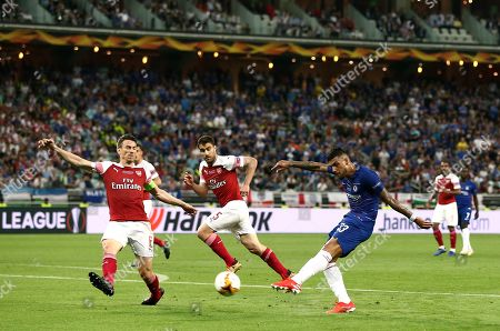 Stock Picture of Emerson Palmieri of Chelsea shoots at goal as Laurent Koscielny of Arsenal blocks