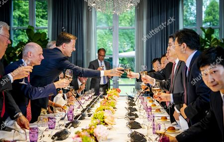 Dutch Prime Minister Mark Rutte (3-L) welcomes Chinese vice president Wang Qishan (4-R) at the Catshuis in the Hague, the Netherlands, 29 May 2019. for a meeting and a work diner, dedicated to the topics of bilateral relations, trade and climate adaptation. Ministers Stef Blok (Foreign Affairs), Sigrid Kaag (Foreign Trade and Development Cooperation) and Cora van Nieuwenhuizen (Infrastructure and Water Management) and representatives from the business community are also present at the dinner.