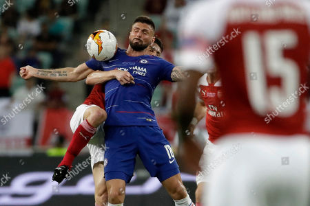 Chelsea's Olivier Giroud, foreground, fights for the ball with Arsenal's Laurent Koscielny during the Europa League Final soccer match between Arsenal and Chelsea at the Olympic stadium in Baku, Azerbaijan