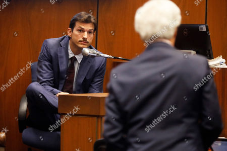 Defense attorney Daniel Nardoni (R) interacts with US actor Ashton Kutcher as he appears in court to testify during the Michael Thomas Gargiulo's trial at the Clara Shortridge Foltz Criminal Justice Center in Los Angeles, California, USA, 29 May 2019. Michael Gargiulo, also called the 'Hollywood Ripper', is charged with murder and attempted murder of young women in the L.A. area. Once the trial is over, Gargiulo will be sent back to Illinois to face murder charges for his alleged first victim.