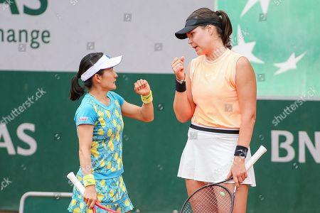 Stock Photo of Shuko Aoyama of Japan and Lidziya Marozava of Bulgaria during the Women's doubles first round match