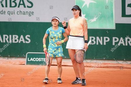 Shuko Aoyama of Japan and Lidziya Marozava of Bulgaria during the Women's doubles first round match