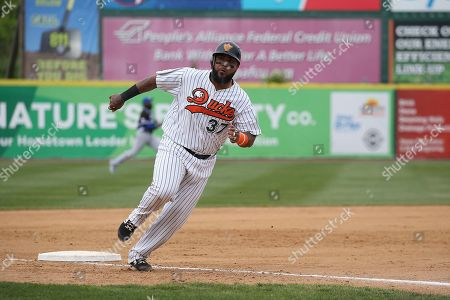 Long Island Duck's catcher Hector Sanchez rounds third during an Atlantic League of Professional Baseball game on in Central Islip, N.Y