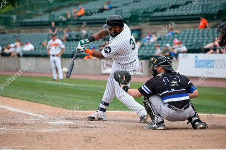 Stock Picture of Long Island Duck's catcher Hector Sanchez bats during an Atlantic League of Professional Baseball game on in Central Islip, N.Y