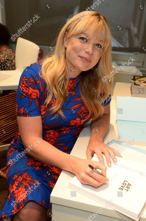 Kate Bryan signing her book 'The Art of Love'