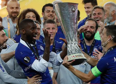 Chelsea's Antonio Ruediger (L) and Cesar Azpilicueta (R) with the trophy after winning the UEFA Europa League final between Chelsea FC and Arsenal FC at the Olympic Stadium in Baku, Azerbaijan, 30 May 2019.