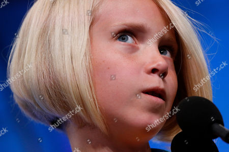 Stock Image of Chloe Garvin, 11, of Helper, Utah, competes in the third round of the Scripps National Spelling Bee, in Oxon Hill, Md