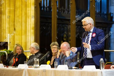 Stock Image of Renew Candidate, Peter Ward, puts his fingers in his ears while SDP Party Candidate Patrick O'Flynn talks.