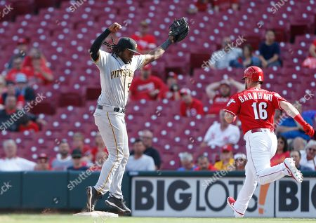 Pittsburgh Pirates first baseman Josh Bell (55) fields a high throw to force out Cincinnati Reds' Tucker Barnhart (16) during the ninth inning of a baseball game, in Cincinnati. The Pirates won 7-2