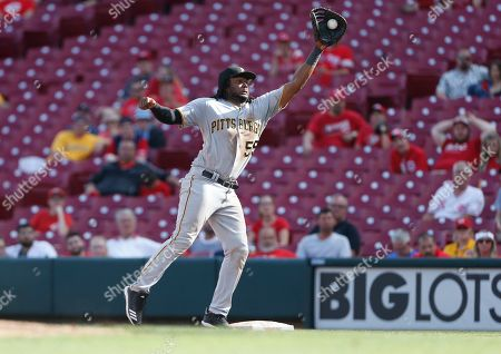Pittsburgh Pirates first baseman Josh Bell (55) fields a high throw to force out Cincinnati Reds' Tucker Barnhart during the ninth inning of a baseball game, in Cincinnati. The Pirates won 7-2