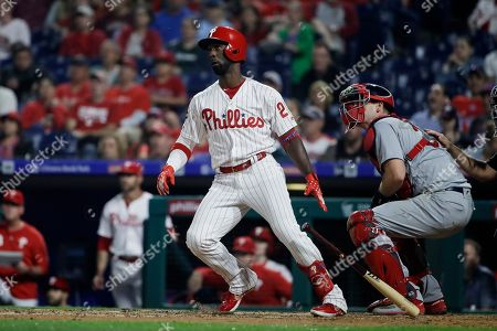 Philadelphia Phillies' Andrew McCutchen follows the flight of the ball after hitting a home run with one run batted in off of St. Louis Cardinals pitcher Michael Wacha during the fifth inning of a baseball game, in Philadelphia