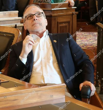 Kansas state Rep. Bradley Ralph, R-Dodge City, watches an electronic vote-tally board as the House considers overriding Democratic Gov. Laura Kelly's veto of a GOP tax relief bill, at the Statehouse in Topeka, Kansas. Ralph backed the bill and the effort to override the veto, but it failed