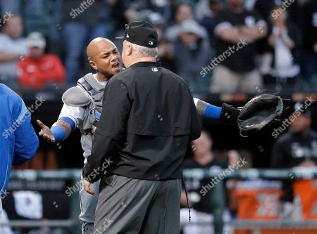 Martin Maldonado, Bill Miller. Kansas City Royals catcher Martin Maldonado, left, appeals to umpire crew chief Bill Miller after home plate umpire Mark Carlson ejected starting pitcher Glenn Sparkman for hitting Chicago White Sox's Tim Anderson with a pitch during the second inning of a baseball game, in Chicago