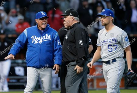 Martin Maldonado, Bill Miller. Kansas City Royals manager Ned Yost, left, appeals to umpire crew chief Bill Miller, center, after home plate umpire Mark Carlson ejected starting pitcher Glenn Sparkman (57) for hitting Chicago White Sox's Tim Anderson with a pitch during the second inning of a baseball game, in Chicago