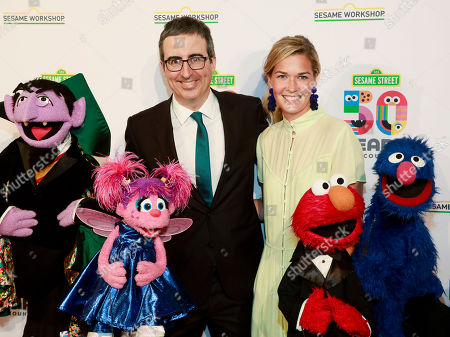 John Oliver, Kate Norley. John Oliver, left, and Kate Norley, right, attend the Sesame Workshop's 50th anniversary benefit gala at Cipriani Wall Street, in New York