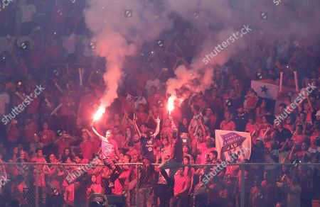 Panamanian fans light flares and cheer during a half time ceremony to retire Jaime Penedo, Felipe Baloy, Blas Perez, Luis Tejada from Panamanian national soccer team, during a friendly soccer match between Panama and the Basque Country in Panama City, Wednesday, May, 29, 2019