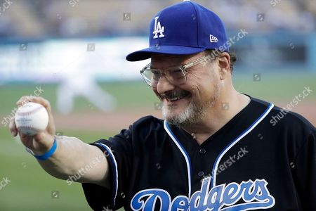 Stock Photo of Actor Wayne Knight prepares to throw the ceremonial first pitch before a baseball game between the Los Angeles Dodgers and the New York Mets, in Los Angeles